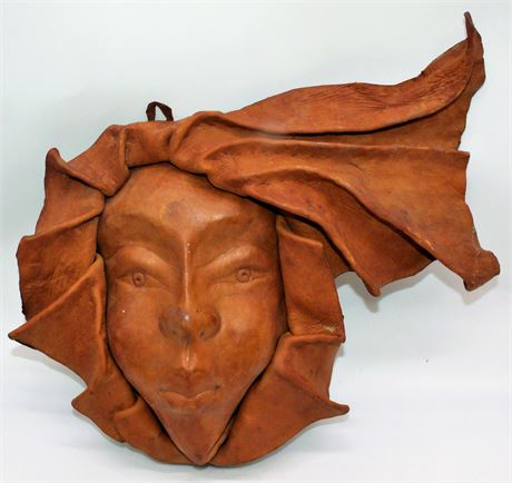 Leather face wall hanging