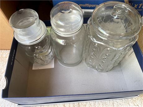 Three decorative glass sealed jars