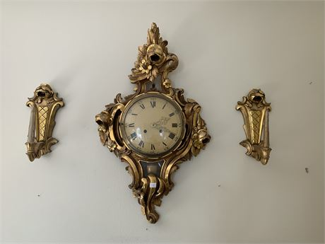 French provincial wall clock in key made in Sweden and candle sconces