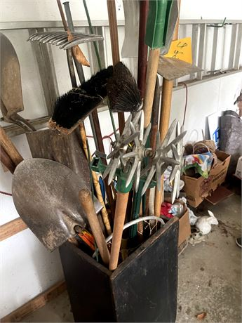 Assorted outdoor tools and container