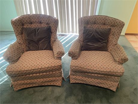 Matching set of conservative print Swivel Chairs with accent pillows