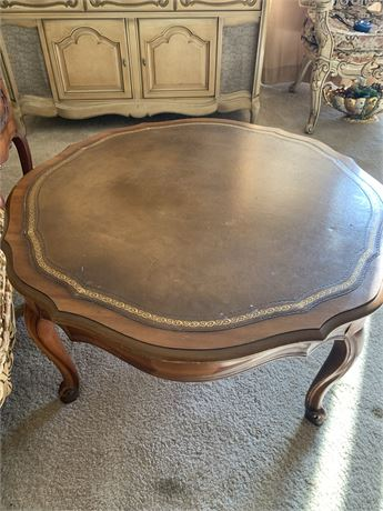 French provincial leather top coffee table