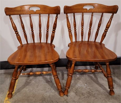 Two wooden colonial wood chairs