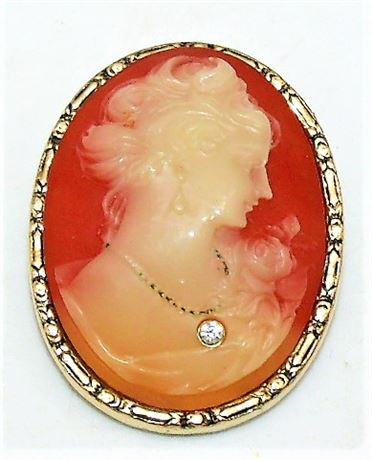 1928 Brand Cameo wearing necklace